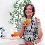 14389832 - happy woman with bowl of fresh and healthy salad